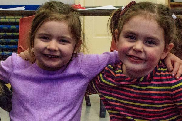 two girls bonding at The Learning Center